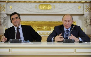 Russia's Prime Minister Vladimir Putin and his French counterpart Francois Fillon attend a news conference during their meeting in Moscow