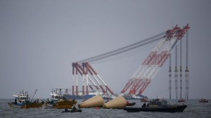 South Korean rescue workers operate near floats where the capsized passenger ship Sewol sank, during the search and rescue operation in the sea off Jindo